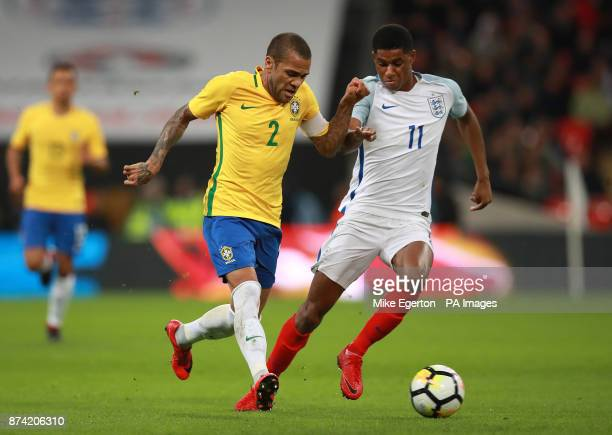 Brazil's Dani Alves and England's Marcus Rashford battle for the ball during the Bobby Moore Fund International match at Wembley Stadium London
