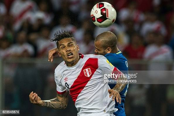 TOPSHOT Brazil's Dani Alves and Peru's forward Paolo Guerrero jump for a header during their 2018 FIFA World Cup qualifier football match in Lima on...