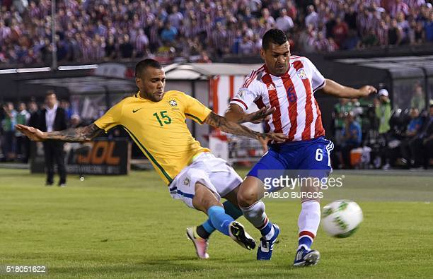 Brazil's Daniel Alves and Paraguay's Miguel Samudio vie for the ball during their Russia 2018 FIFA World Cup South American Qualifiers' football...