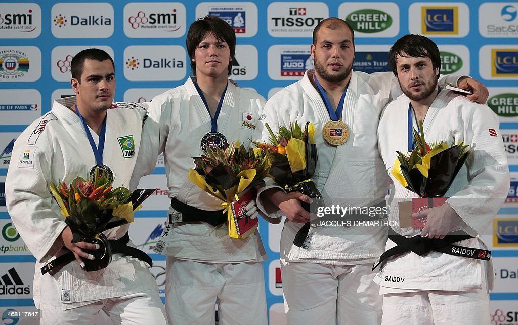 Brazil's David Moura Japan's Shichinohe Ryu Tunisia's Faicel Jaballah and Russian Renat Saidov pose during the podium ceremony for the men's 100kg...
