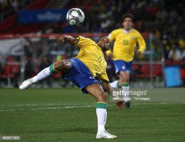 Brazil's De Souza Robinho has a shot on goal