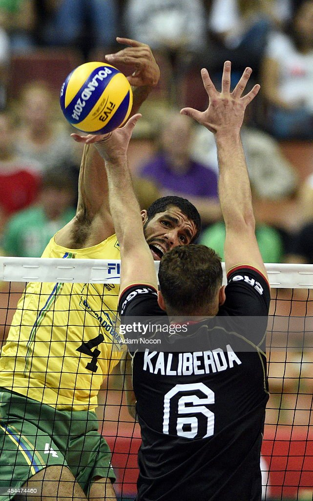 Brazil's De Suoa Wallace attacks German's defense Denys Kaliberda during the FIVB World Championships match between Brazil and Germany on September 1, 2014 in Katowice, Poland.