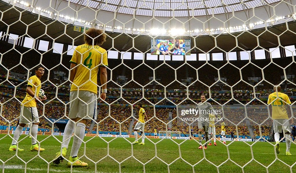 Brazil's defender and captain Thiago Silva, defender David Luiz and goalkeeper Julio Cesar react after conceding a second goal during the third place play-off football match between Brazil and Netherlands during the 2014 FIFA World Cup at the National Stadium in Brasilia on July 12, 2014. AFP PHOTO / VANDERLEI ALMEIDA