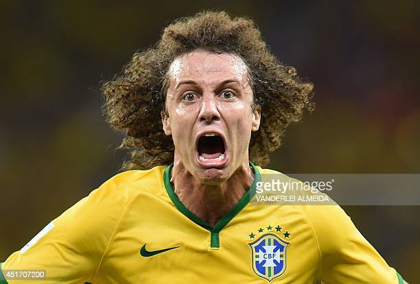Brazil's defender David Luiz celebrates scoring during the quarterfinal football match between Brazil and Colombia at the Castelao Stadium in...