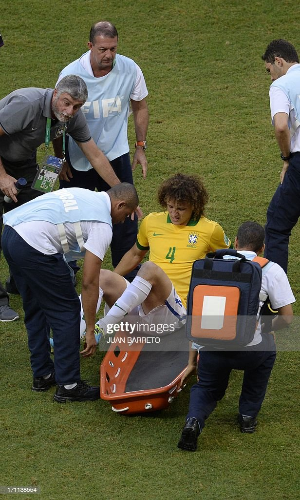 Brazil's defender David Luiz gets onto a stretcher during the FIFA Confederations Cup Brazil 2013 Group A football match against Italy, at the Fonte Nova Arena in Salvador, on June 22, 2013. AFP PHOTO / JUAN BARRETO