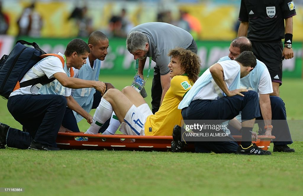 Brazil's defender David Luiz is lifted onto a stretcher during the FIFA Confederations Cup Brazil 2013 Group A football match against Italy, at the Fonte Nova Arena in Salvador, on June 22, 2013. Brazil won 4-2.