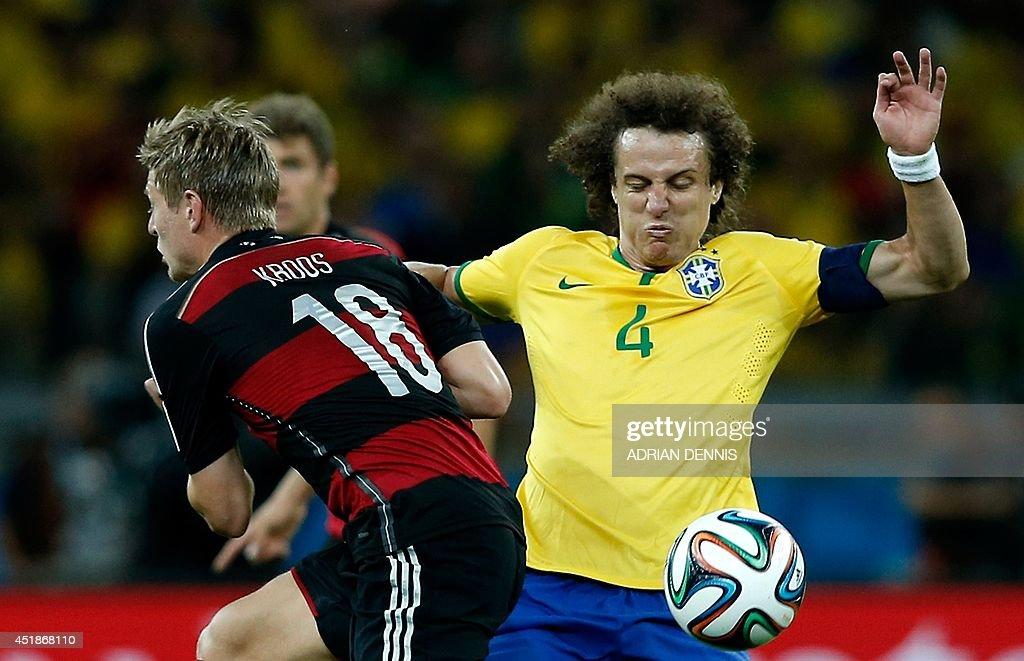brazils-defender-david-luiz-vies-with-germanys-midfielder-toni-kroos-picture-id451868110