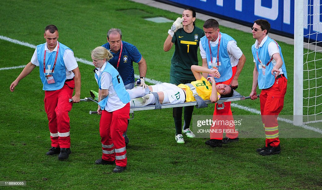 Brazil's defender Erika is carried from the pitch during the quarterfinal match of the FIFA women's football World Cup Brazil vs USA on July 10 2011...