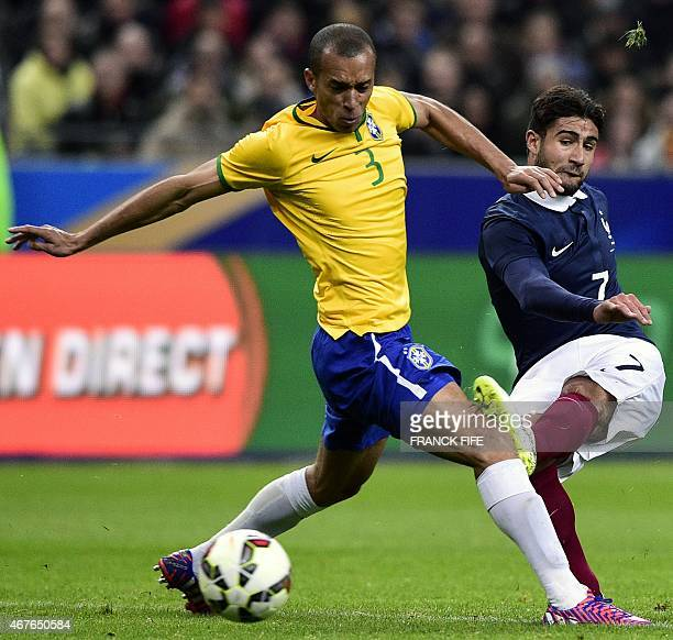 Brazil's defender Joao Miranda vies with France's forward Nabil Fekir during the friendly football match France vs Brazil on March 26 2015 at the...