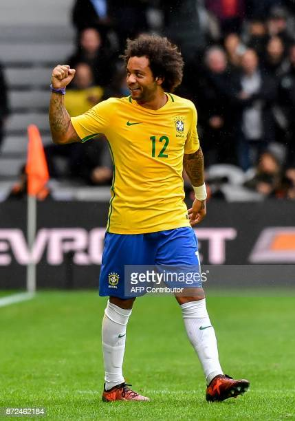 Brazil's defender Marcelo reacts after scoring a goal during the friendly football match between Brasil and Japan at the PierreMauroy Stadium in...