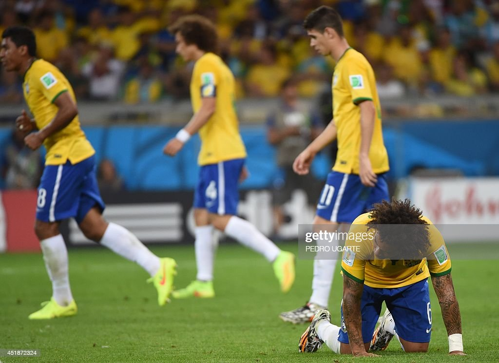 Brazil's defender Marcelo reacts after unseen Germany's forward Andre Schuerrle scored during the semifinal football match between Brazil and Germany...