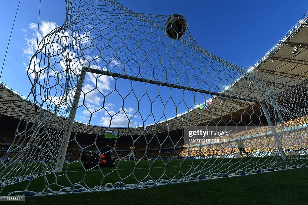 Brazil's defender Marcelo scores during the penalty shootout after the extra time in the round of 16 football match between Brazil and Chile at The...