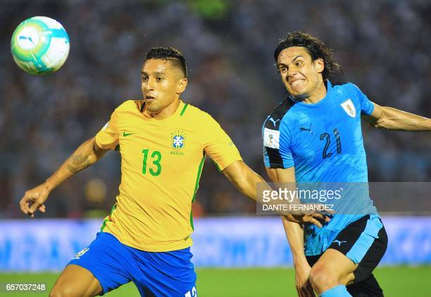 Brazil's defender Marquinhos vies for the ball with Uruguay's Edinson Cavani during their 2018 FIFA World Cup qualifier football match at the...