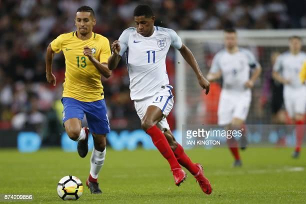 Brazil's defender Marquinhos vies with England's striker Marcus Rashford during the international friendly football match between England and Brazil...