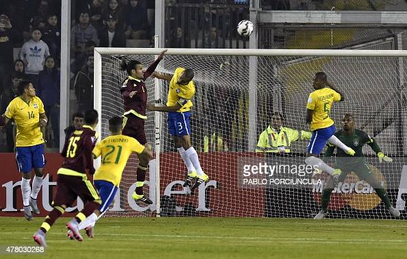 Brazil's defender Miranda and Venezuela's defender Oswaldo Vizcarrondo jump for a header during their 2015 Copa America football championship match...