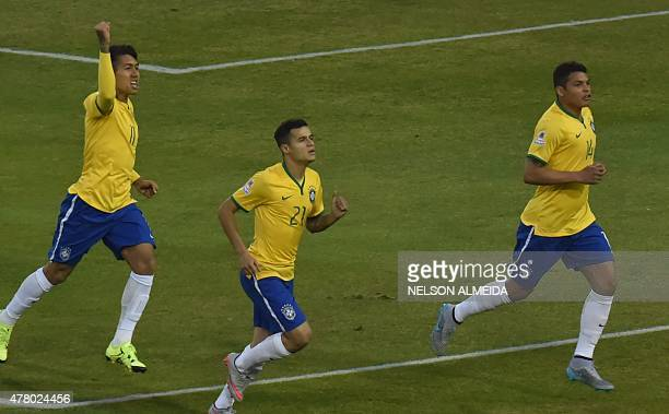 Brazil's defender Thiago Silva celebrates with Brazil's forward Roberto Firmino and Brazil's midfielder Philippe Coutinho after scoring against...