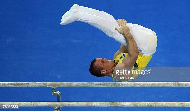 Brazil's Diego Hypolito performs on the parallel bars during the men's qualifying round of the 40th World Artistic Gymnastics Championships 03...