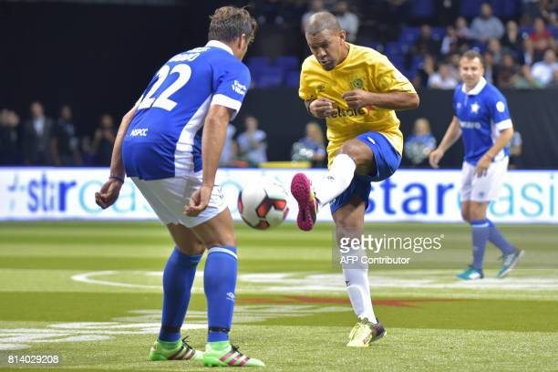 Brazil's Djalminha vies with Italy's Massimo Oddo during the Star Sixes football match between Brazil and Italy at the O2 Arena in London on July 13...