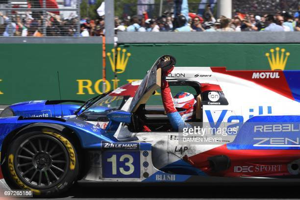 Brazils' driver Nelson Piquet Jr on his Vaillante Rebellion Oreca 07 Gibson N°13 celebrates after finishing third of the Le Mans 24 hours endurance...