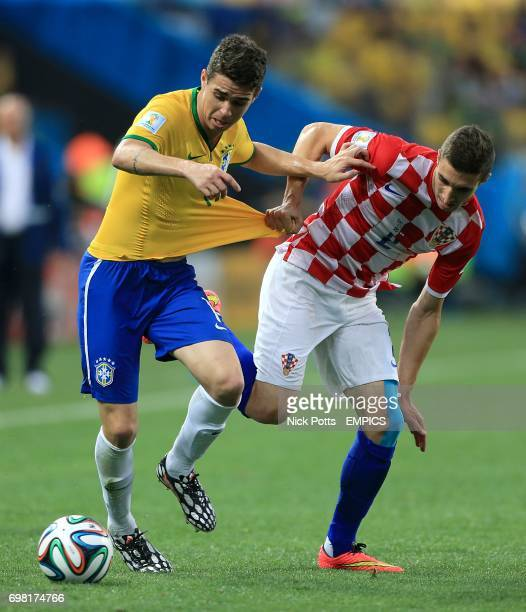 Brazil's Emboaba Oscar and Croatia's Sime Vrsaljko battle for the ball
