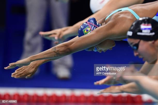 Brazil's Etiene Medeiros takes the start in a heat of the women's 50m freestyle during the swimming competition at the 2017 FINA World Championships...