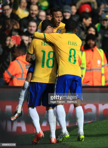 Brazil's Fabinho celebrates scoring his sides first goal of the game against Chile with Neymar facing and Elias