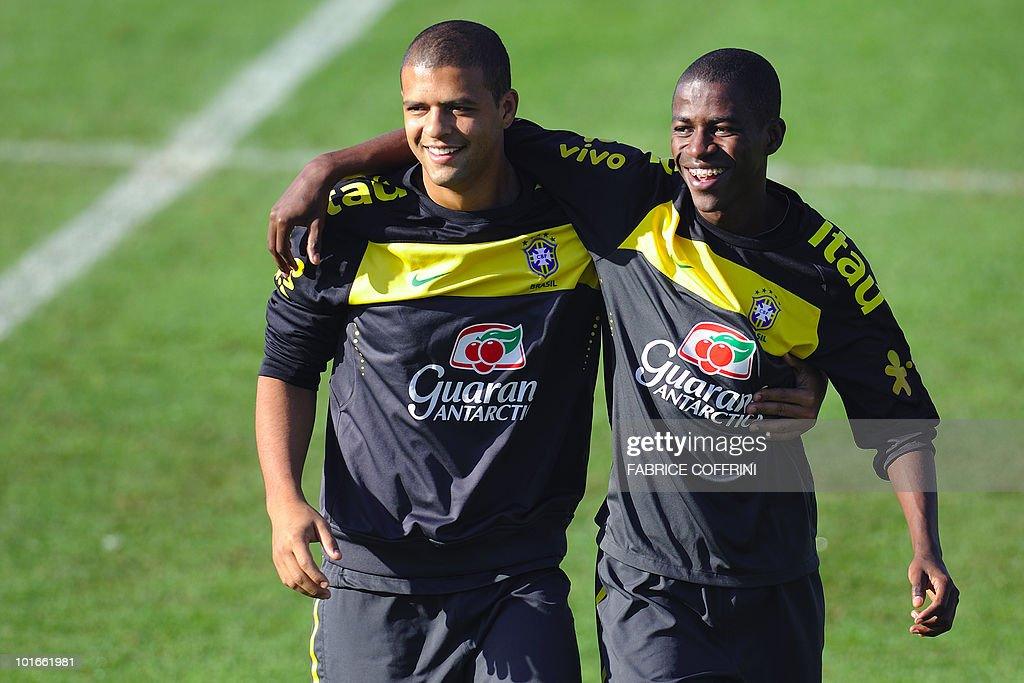 Brazil's Felipe Melo (L) stands with teammate Ramires during a training session at the Randburg High School on June 6, 2010 in Johannesburg ahead of the kick off of the South Africa 2010 World Cup. The 2010 World Cup will take place in South Africa from June 11 to July 11, the first time on African soil for the biggest and most prestigious competition in sport.