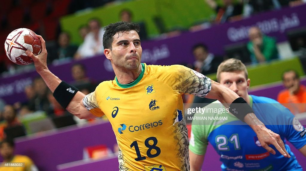 Brazil's <a gi-track='captionPersonalityLinkClicked' href=/galleries/search?phrase=Felipe+Ribeiro&family=editorial&specificpeople=4113764 ng-click='$event.stopPropagation()'>Felipe Ribeiro</a> attempts a shot on goal (L) as Slovenia's Blaz Blagotinsek looks on during the 24th Men's Handball World Championships preliminary round Group A match between Brazil and Slovenia at the Duhail Handball Sports Hall in Doha on January 21, 2015. AFP PHOTO / MARWAN NAAMANI