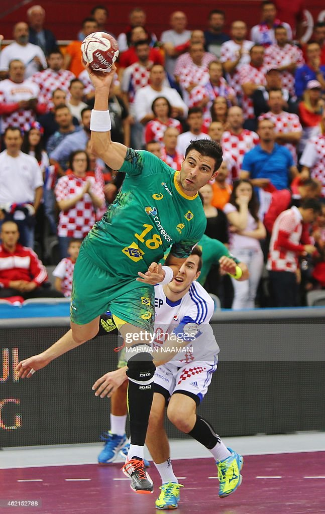 Brazil's <a gi-track='captionPersonalityLinkClicked' href=/galleries/search?phrase=Felipe+Ribeiro&family=editorial&specificpeople=4113764 ng-click='$event.stopPropagation()'>Felipe Ribeiro</a> attempts a shot on goal during the 24th Men's Handball World Championships Eighth Final EF7 match between Croatia and Brazil at the Ali Bin Hamad Al Attiya Arena in Doha on January 25, 2015.