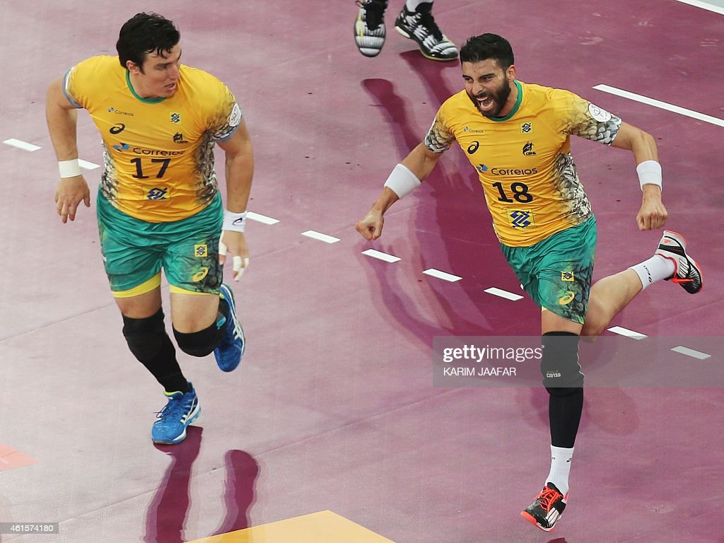 Brazil's <a gi-track='captionPersonalityLinkClicked' href=/galleries/search?phrase=Felipe+Ribeiro&family=editorial&specificpeople=4113764 ng-click='$event.stopPropagation()'>Felipe Ribeiro</a> (R) celebrates scoring during the 24th Men's Handball World Championships preliminary round Group A match Qatar vs Brazil at the Lusail Multipurpose Hall in Doha on January 15, 2015.