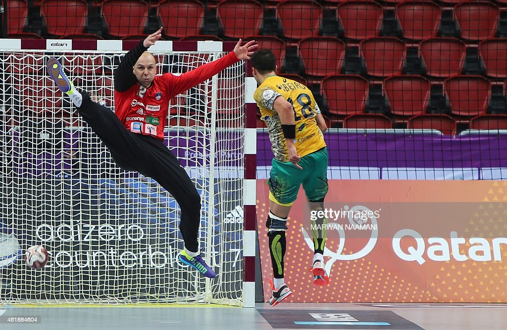 Brazil's <a gi-track='captionPersonalityLinkClicked' href=/galleries/search?phrase=Felipe+Ribeiro&family=editorial&specificpeople=4113764 ng-click='$event.stopPropagation()'>Felipe Ribeiro</a> scores a goal during the 24th Men's Handball World Championships preliminary round Group A match between Brazil and Slovenia at the Duhail Handball Sports Hall in Doha on January 21, 2015.