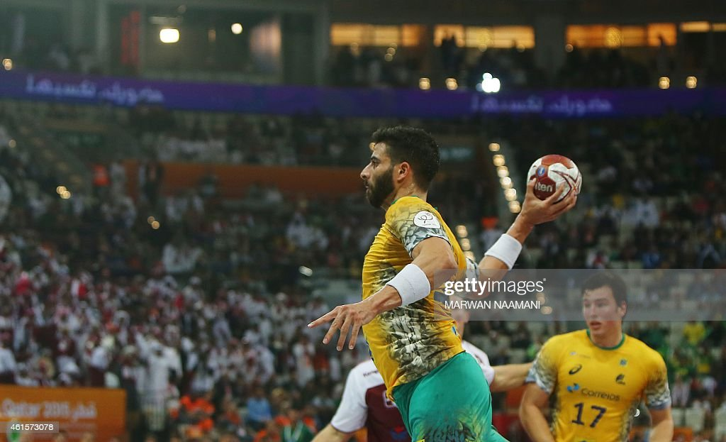 Brazil's <a gi-track='captionPersonalityLinkClicked' href=/galleries/search?phrase=Felipe+Ribeiro&family=editorial&specificpeople=4113764 ng-click='$event.stopPropagation()'>Felipe Ribeiro</a> shoots the ball during the 24th Men's Handball World Championships preliminary round Group A match Qatar vs Brazil at the Lusail Multipurpose Hall in Doha on January 15, 2015. AFP PHOTO / MARWAN NAAMANI