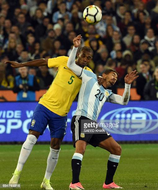 Brazil's Fernando Roza fights for the ball with Argentina's Manuel Lanzini during the friendly international football match between Brazil and...