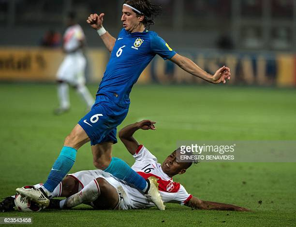 Brazil's Filipe Luis and Peru's midfielder Pedro Aquino vie for the ball during their 2018 FIFA World Cup qualifier football match in Lima on...
