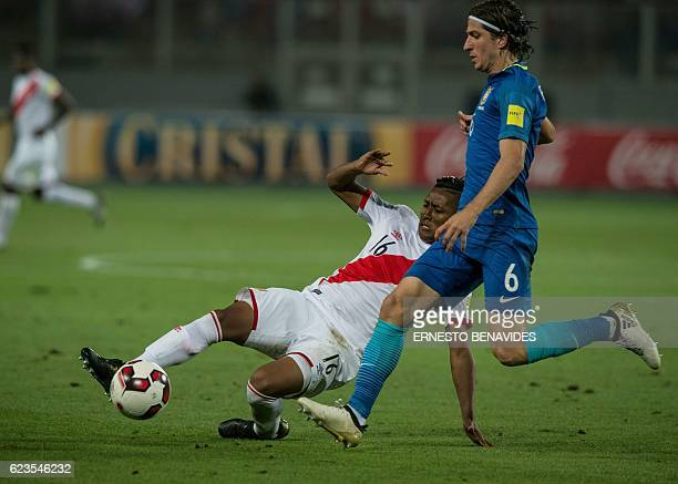 Brazil's Filipe Luis is marked by Peru's Pedro Aquino during their 2018 FIFA World Cup qualifier football match in Lima on November 15 2016 / AFP /...