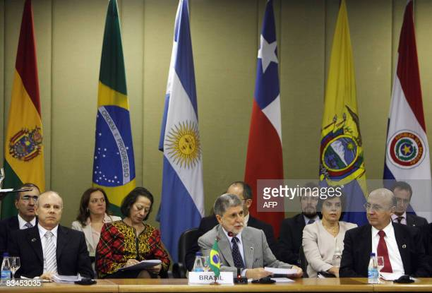 Brazil's Finance Minister Guido Mantega Foreign Minister Celso Amorim and Cental Bank President Henrique Meirelles attend a meeting of the Mercosur...