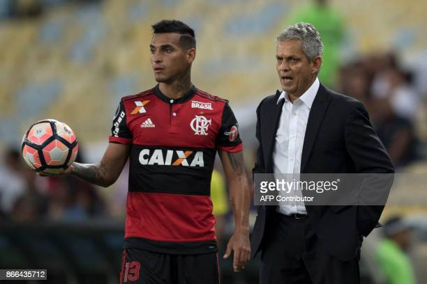 Brazil's Flamengo coach Reinaldo Rueda talks with his player Miguel Trauco during the 2017 Sudamericana Cup football match against Fluminense at...