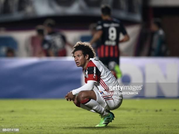 Brazil's Flamengo defender Rafael Vaz reacts after Argentina's San Lorenzo midfielder Fernando Belluschi scored a goal during their Copa Libertadores...