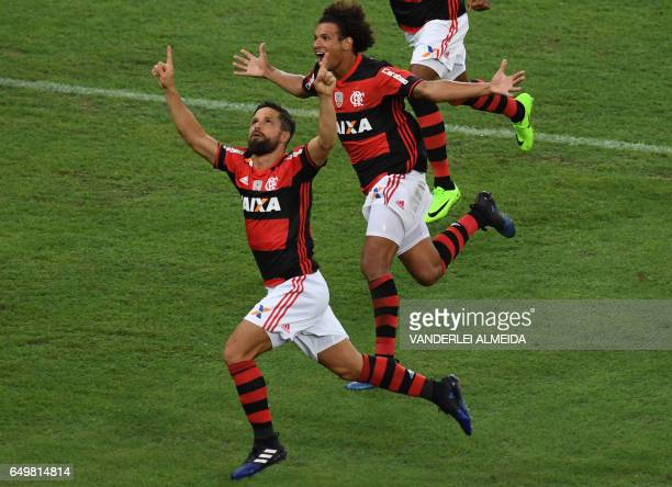 Brazil's Flamengo Diego Ribas celebrates with teammate Willian Arao after scoring against Argentina's San Lorenzo during their Libertadores Cup...