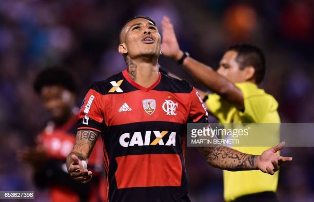 Brazil's Flamengo footballer Paolo Guerrero reacts after failing a goal against Chile's Universidad Catolica during their Libertadores Cup football...