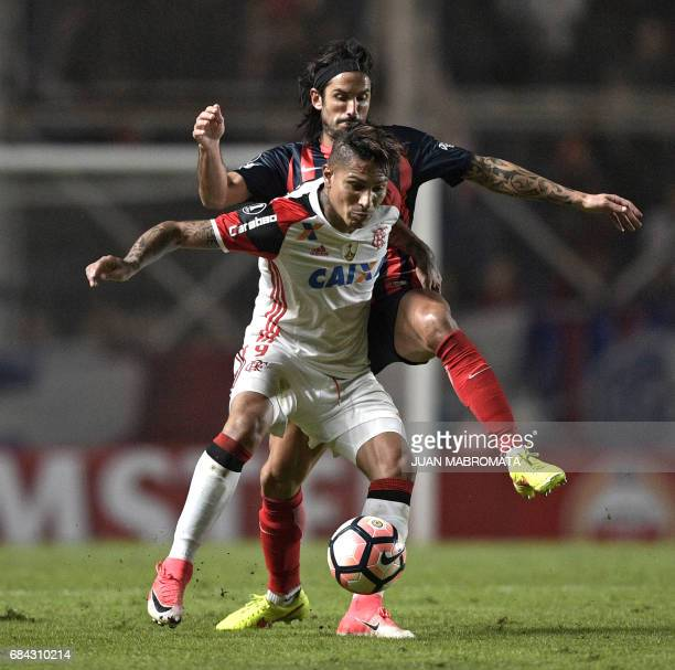 Brazil's Flamengo forward Paolo Guerrero vies for the ball with Argentina's San Lorenzo defender Marcos Angeleri during their Copa Libertadores 2017...