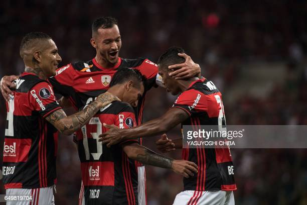 Brazil's Flamengo Miguel Trauco celebrates with teammates after scoring a second goal against Argentina's San Lorenzo during their Libertadores Cup...