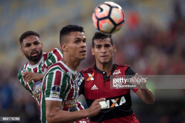 Brazil's Flamengo player Miguel Trauco vies for the ball with Brazil's Fluminense players Romarinho and Richard during their 2017 Sudamericana Cup...