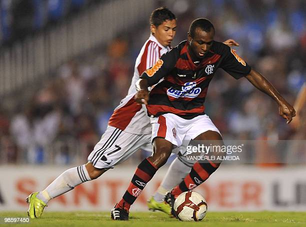Brazil's Flamengo player Vinicius Pacheco vies for the ball with Venezuela's Caracas player Cesar Gonzalez during their Libertadores Cup football...
