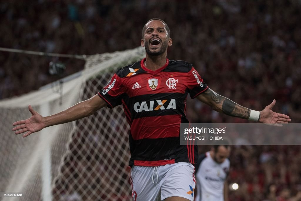 Brazil's Flamengo Romulo celebrates after scoring against Argentina's San Lorenzo during their Libertadores Cup football match at Maracana stadium in Rio de Janeiro, Brazil on March 8, 2017. / AFP PHOTO / Yasuyoshi Chiba