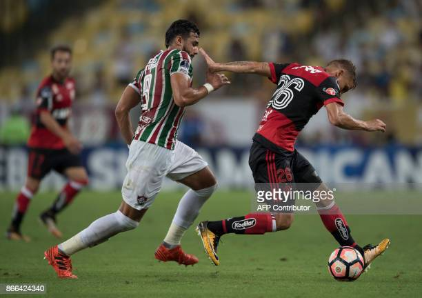 Brazil's Fluminense Henrique Dourado vies for the ball with Brazil's Flamengo Gustavo Cuellar during the 2017 Sudamericana Cup football match at...