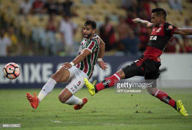 Brazil's Fluminense Henrique Dourado vies for the ball with Brazil's Flamengo Miguel Trauco during the 2017 Sudamericana Cup football match at...