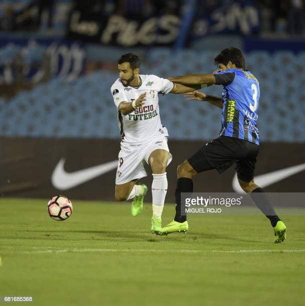 Brazil's Fluminense Henrique Dourado vies for the ball with Uruguay's Liverpool Facundo Mallo during their Sudamericana Cup football match at the...