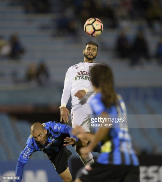 Brazil's Fluminense Henrique Dourado vies for the ball with Uruguay's Liverpool Gustavo Aprile during their Sudamericana Cup football match at the...