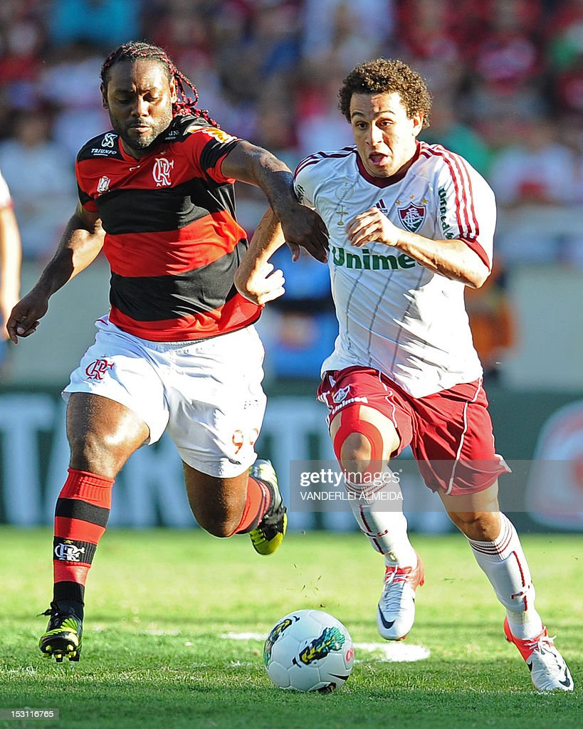 Brazil's Fluminense player Wellington Nem vies for the ball with Flamengo's Wagner Love during a Brazilian Championship football match at the Joao...